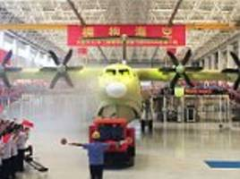It's a sea monster! China unveils world's largest amphibious aircraft used to fight forest fires and perform marine rescues