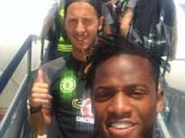 michy batshuayi hooks up with returning team-mate eden hazard as chelsea squad take flight for us tour