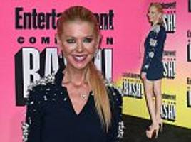 tara reid flaunts her very svelte frame in heavily embellished navy mini-dress and skyscraper heels at comic-con event
