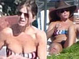 Jennifer Aniston enjoys tanning session as she relaxes with friends in Italy