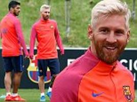 Barcelona stars including Lionel Messi and Luis Suarez train at St George's Park as they undergo a six-day training camp