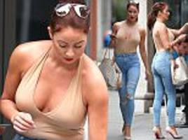 big brother's laura carter puts on a busty display in nude halter top