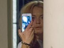 PICTURED: Lindsay Lohan looks stressed following explosive fight with Russian fiancé Egor Tarabasov