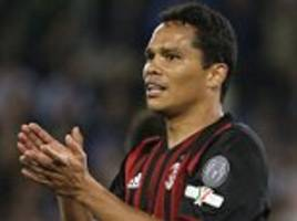 barcelona interested in move for carlos bacca as ac milan forward maintains desire to play champions league football
