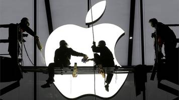Apple sees iPhone sales drop again but beats forecasts