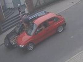dramatic cctv footage shows a road rage row in luban poland row end when a bmw driver has to leap onto the roof of his car to avoid being mown down by a maniac in a mazda