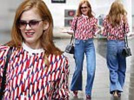 isla fisher heads to radio interview wearing retro top and flares