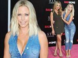 Kendra Wilkinson gets hands-on with pal Jessica Hall at Bad Moms premiere