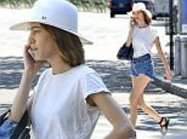 Supermodel Alexa Chung looks leggy in tiny hotpants and a casual tee as she grabs a bite to eat in New York City