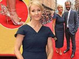 J.K Rowling stuns in navy dress as she makes rare red carpet appearance with her husband Dr. Neil Murray at Harry Potter play premiere