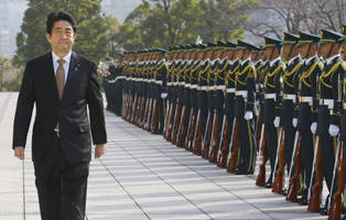 japanese government shifts further toward authoritarianism and militarism