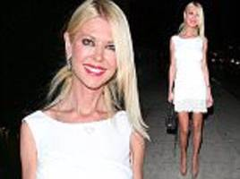 tara reid displays her svelte frame in sexy mini dress as she attends charity fundraiser in la