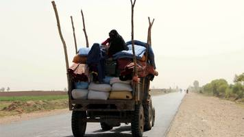 taliban conflict: thousands flee as fighting threatens helmand