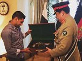 amir khan presented with 17th century pistol by pakistani military chief during visit to rawalpindi