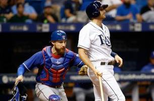 rays held hitless until 6th inning, drop opener to rangers