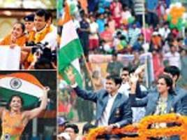 india's olympic daughters sindhu and dipa return home from rio to a rapturous welcome after making the country proud