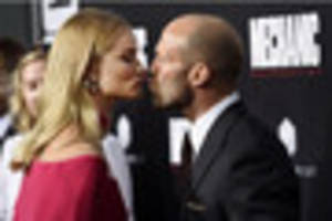 Plymouth star Rosie at Hollywood premier with fiance Jason...
