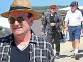 u2's bono and microsoft founder bill gates, worth a combined £59.8billion, enjoy a lunch in st tropez with their wives