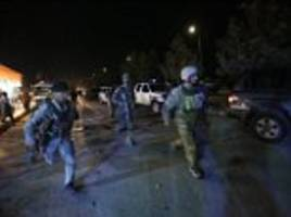 American University in Kabul under attack: Gunmen storm campus packed with students as explosions are heard and trapped victims tweet from inside 'I'm wounded please help us'