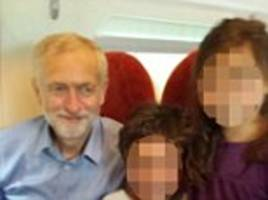 happy now, jeremy? corbyn is all smiles after definitely getting a seat on virgin train in the wake of his bitter row with sir richard branson