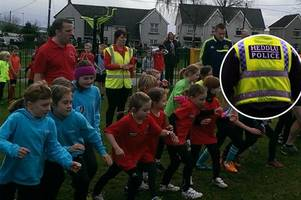 these young athletes with olympic aspirations are being mentored...by a police officer