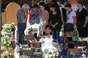 Tears flow as Italy prepares state funeral for quake dead