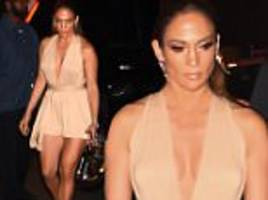Jennifer Lopez sports extremely low-cut mini dress at Marc Anthony's concert