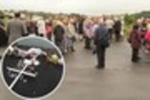tears and grief at memorial service for the victims of hooe lake...