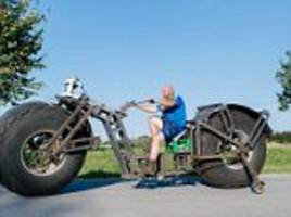 that's wheelie big! german man has built a bicycle weighing nearly a tonne which he claims is the heaviest in the world – but he has to ride it for 500 yards to win the official record