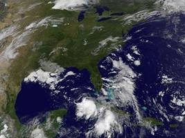 hurricane gaston stalls; depressions aim for florida, n.c.