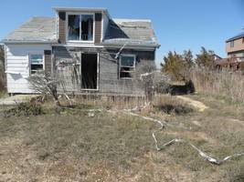 sandy-battered houses must come down, councilman says