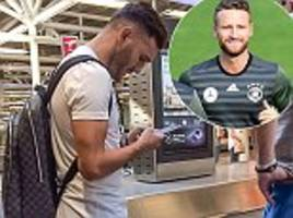 Lucas Perez pictured at Heathrow Airport and Shkodran Mustafi trains with German national team as pair move closer to official moves