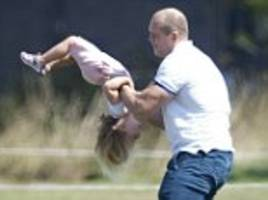 mike tindall grabs giggling daughter by the dungarees in playful fight
