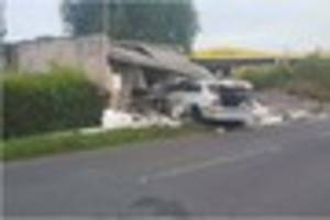 Police hunt driver after car ploughs into Glastonbury building at...