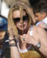 lindsay lohan flashes nipple and bum in double wardrobe fail