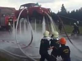it's a flying car! ingenious firefighters lift a classic trabant into the air just by using their powerful hoses