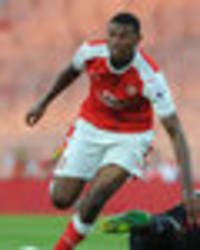 who is the unknown player included in arsenal squad on their official website?