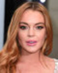 lohan finally letting go? cash-strapped lindsay to sell £255k diamond engagement ring