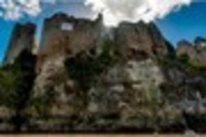 video: cliff diver plunges 85ft from castle in to river wye