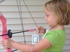 now that's brave! five-year-old girl with a wobbly tooth removes it by tying it to an arrow and firing it from a bow