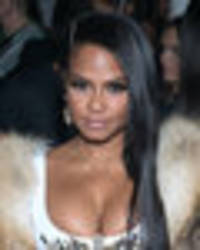 cleavage that can't be contained: christina milian's assets try to make a break for it