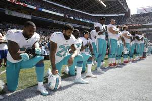 kate upton says dolphins' national anthem protest 'a disgrace'