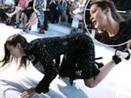 bella hadid takes a painful stumble on michael kors runway while in six inch heels after kendall jenner struts her stuff