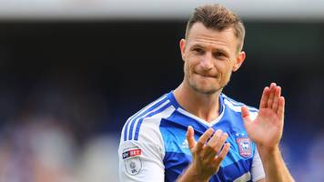 tommy smith: ipswich town and new zealand defender to have back surgery