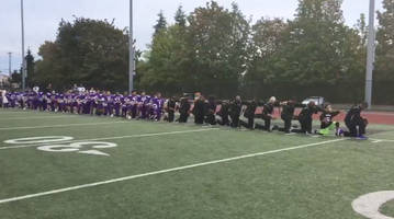 Seattle high school football team kneels in unison during national anthem