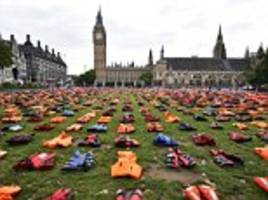 anger as london's labour mayor allows a refugee charity headed by ex-minister david miliband to take over parliament square with a 'graveyard of lifejackets' demo