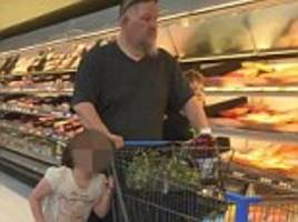 woman snaps photos of a man who had a little girl's hair 'wrapped around a buggy' as he dragged her down the aisles in a texas walmart