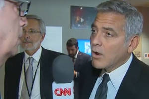 george clooney reacts to brangelina divorce after learning about it during cnn interview (video)