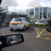 Driving school snapped parking in disabled parking space