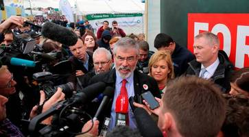 furious gerry adams threatens to sue bbc and says he will meet with police